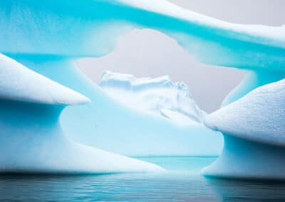 window created through a turquoise blue glacier in greenland by dave brosha canadian outdoor photographer and speaker at conference and chill