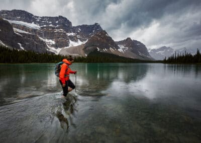 meghan ward, canadian outdoor adventure writer, crosses a lake in the crowfoot glacier. image by husband paul zizka, canadian outdoor photographer